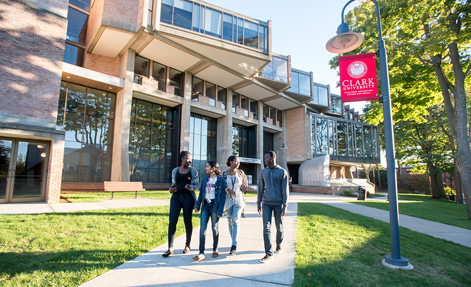 graduate students walking down path