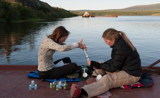 Karen Frey taking samples at pond