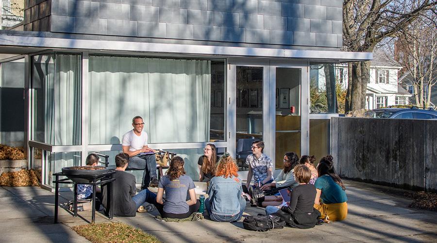 professor teaching class outdoors