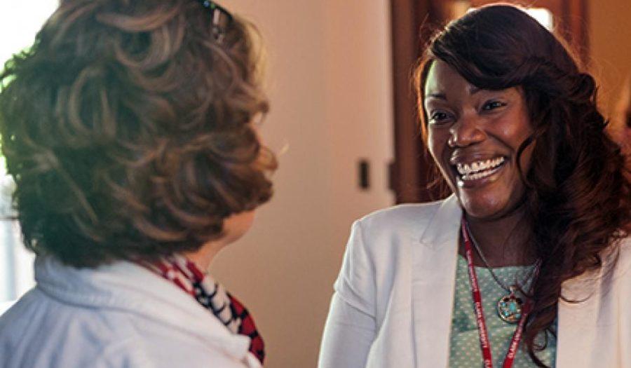two women talking in hall way