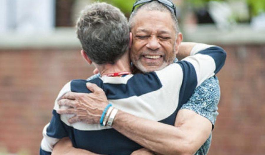 male hugging female welcoming