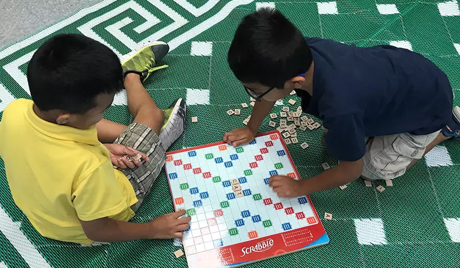 young boys playing board game