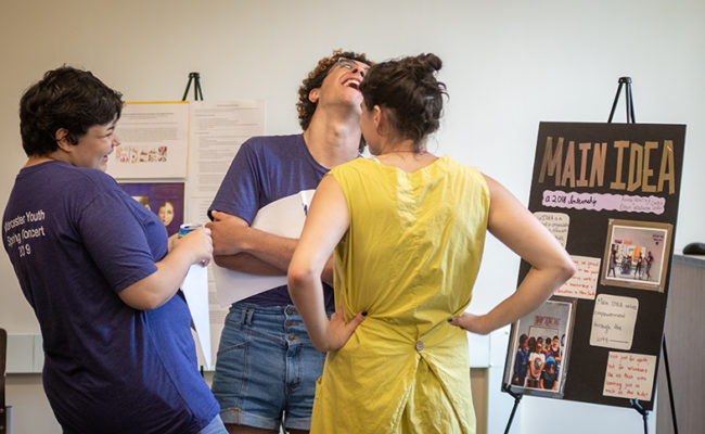 Three students connecting and laughing