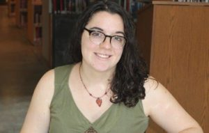 HGS concentrator Marisa Natalie '17, working on the Robert Messing (59') Holocaust Numismatic Collection