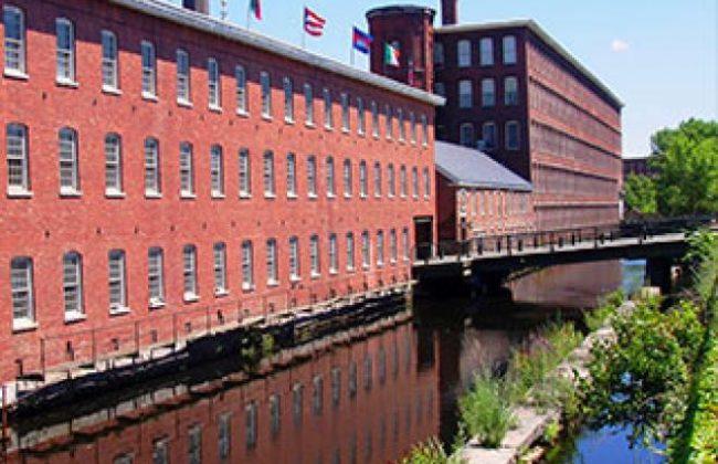 brick building next to river