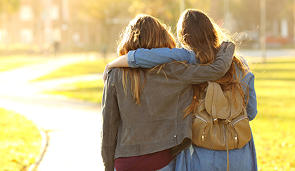 Two college students hugging