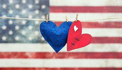 Two hearts in front of American flag