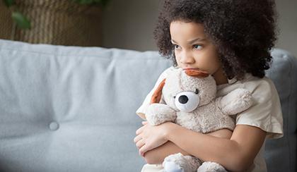 sad child holding rabbit
