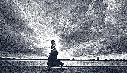 Somali woman walking on beach