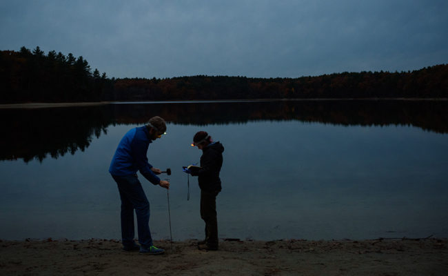 Professor and student at Walden Pond conducting tests