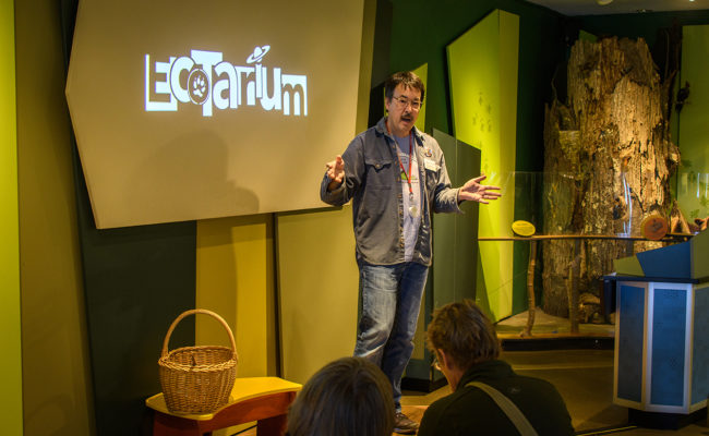 David Hibbett speaking to audience at Ecotarium