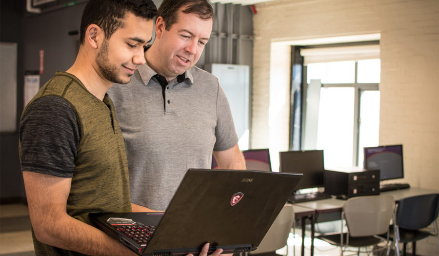 professor john mcgee with student