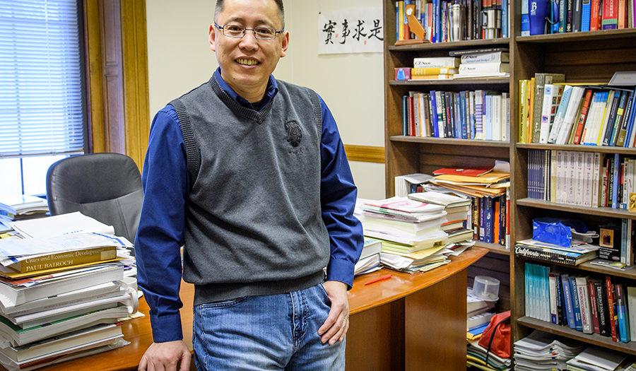 Junfu Zhang in his office