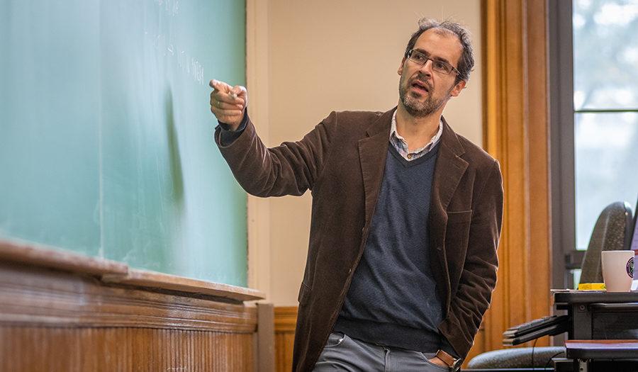 David Cuberes teaching at the blackboard