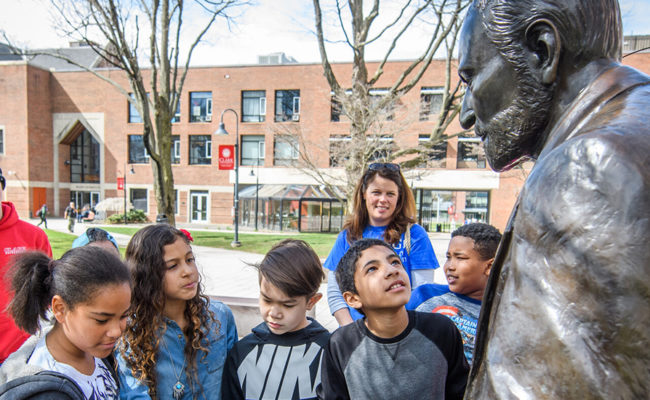 young students admiring Sigmund Freud statue