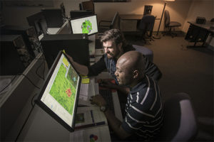 two men looking at heat maps