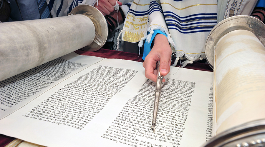 jewish leader pointing to book