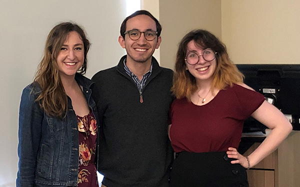 Three students posed