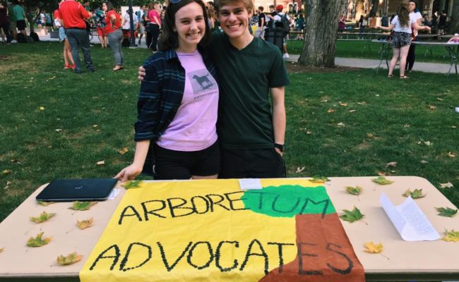 two students with banner