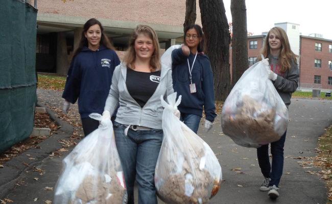 girls carrying trash