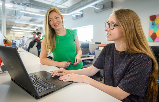 woman overviewing intern student