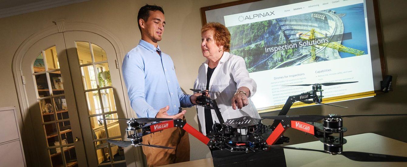 professor talking to student about drone