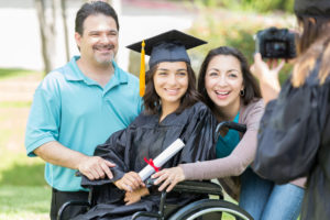 female student in wheel chair with parents