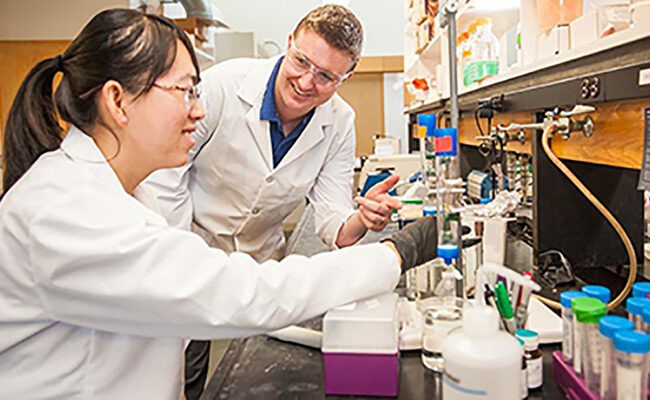 Professor in lab working with doctoral student
