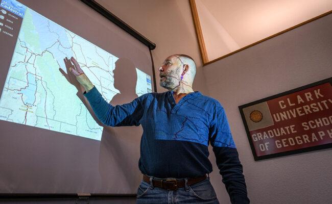 Professor pointing at slideshow
