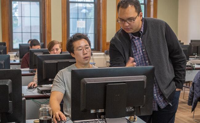 Professor and student in statistics lab