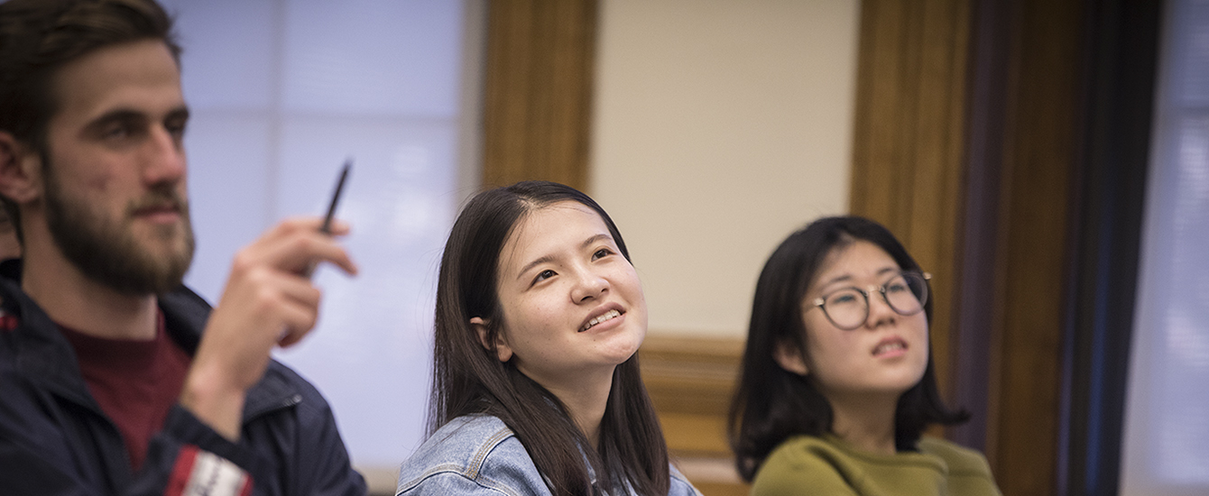 undergraduate students looking up in classroom