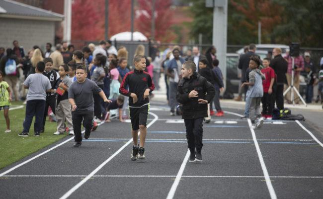 kids running around track