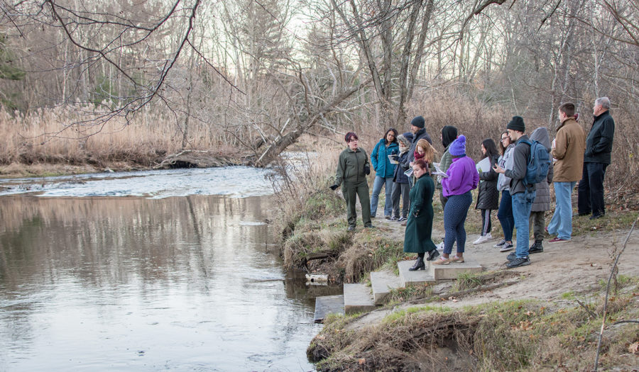 students standing on the edge of a river