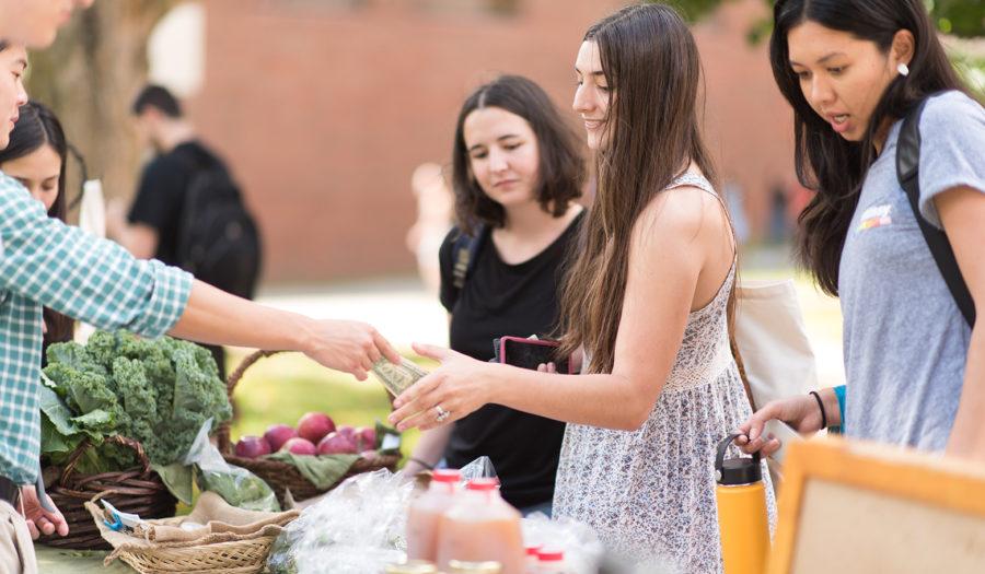 woman buying veggies at market