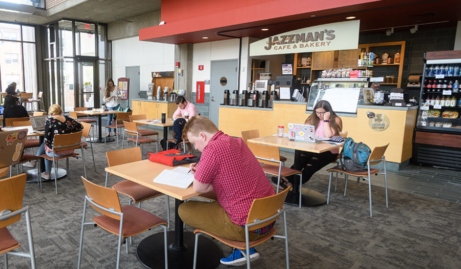 shot of students sitting at Jazzman restaurant tables