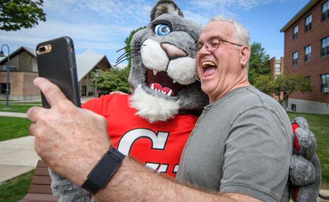 dad taking selfie with mascot