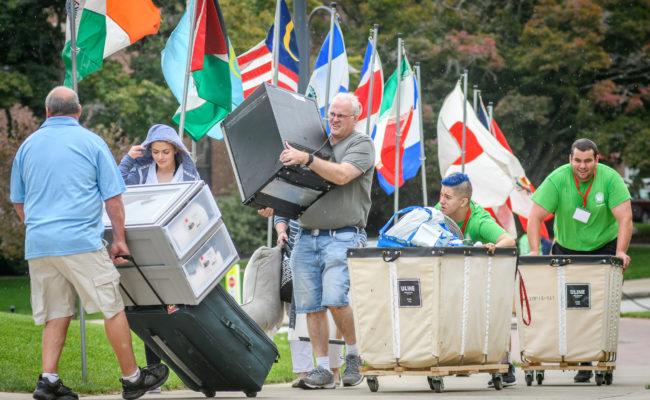 parents helping child move child i
