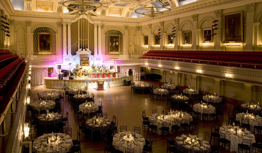 picture of white tables in great hall for performance
