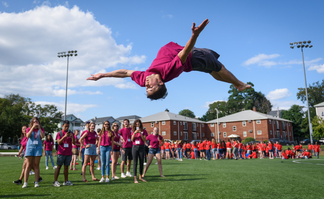 Student jumping upside down