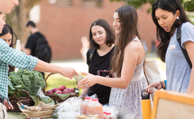 students buying food off table
