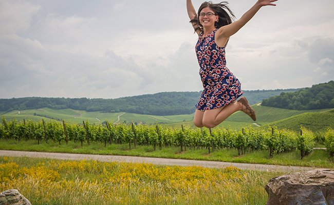 students jumping in field