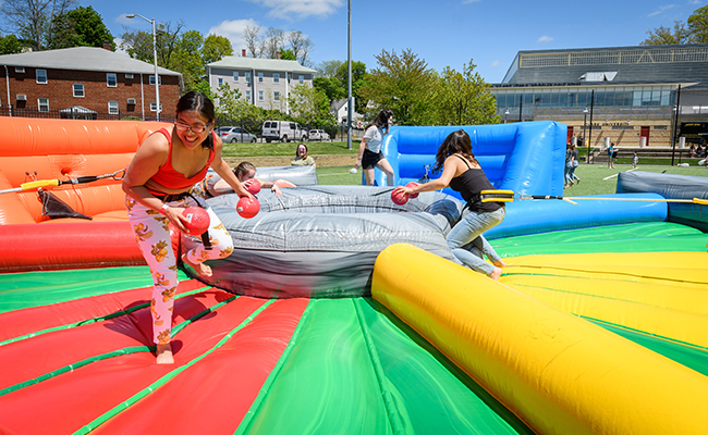 students in blowup amusement slide