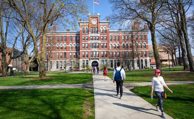 Jonas clark building with student walking towards it