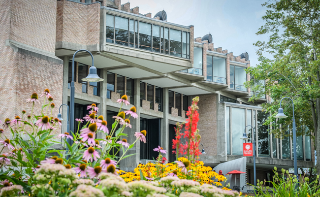 campus building with flowers