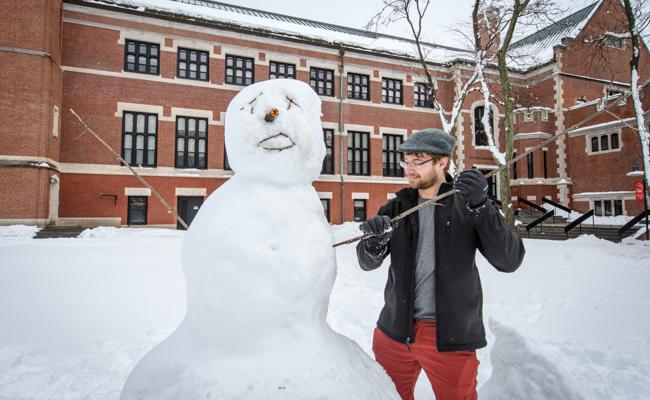 student building snowman