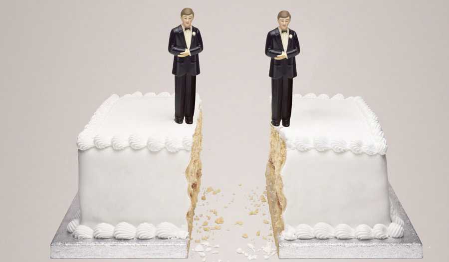 wedding cake with two male statues on
